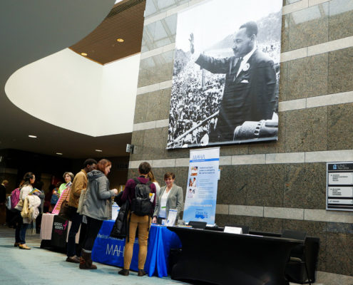 Atrium with Martin Luther King Jr. banner and line for information.