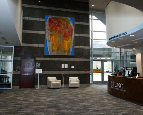 There are gathering spaces and a staffed front desk at the main building entrance